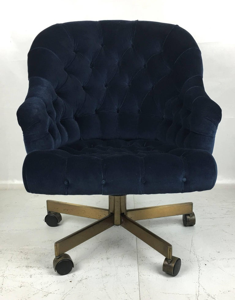 Classic Dunbar executive swivel chair freshly upholstered in luxurious Navy velvet . The chair is fully adjustable and super comfortable. Raised on a bronze-plated steel base with bronze hooded casters.