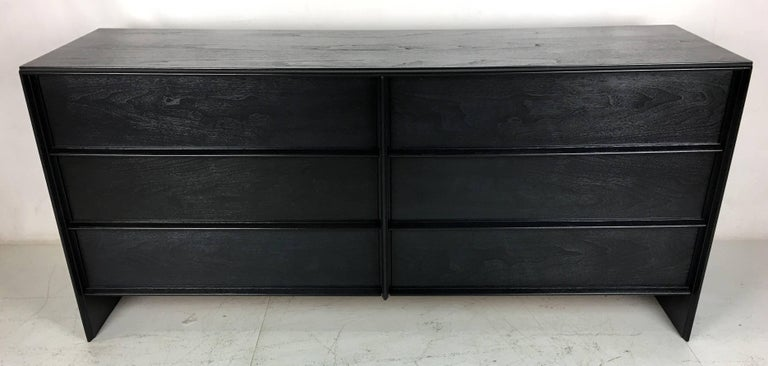 A beautiful example of this classic Modern Thinline Dresser by T.H. Robsjohn-Gibbings for Widdicomb refinished in a deep charcoal grey lacquer. We've worked on this color for a long time and we finally got it just right. It's a chic update for this