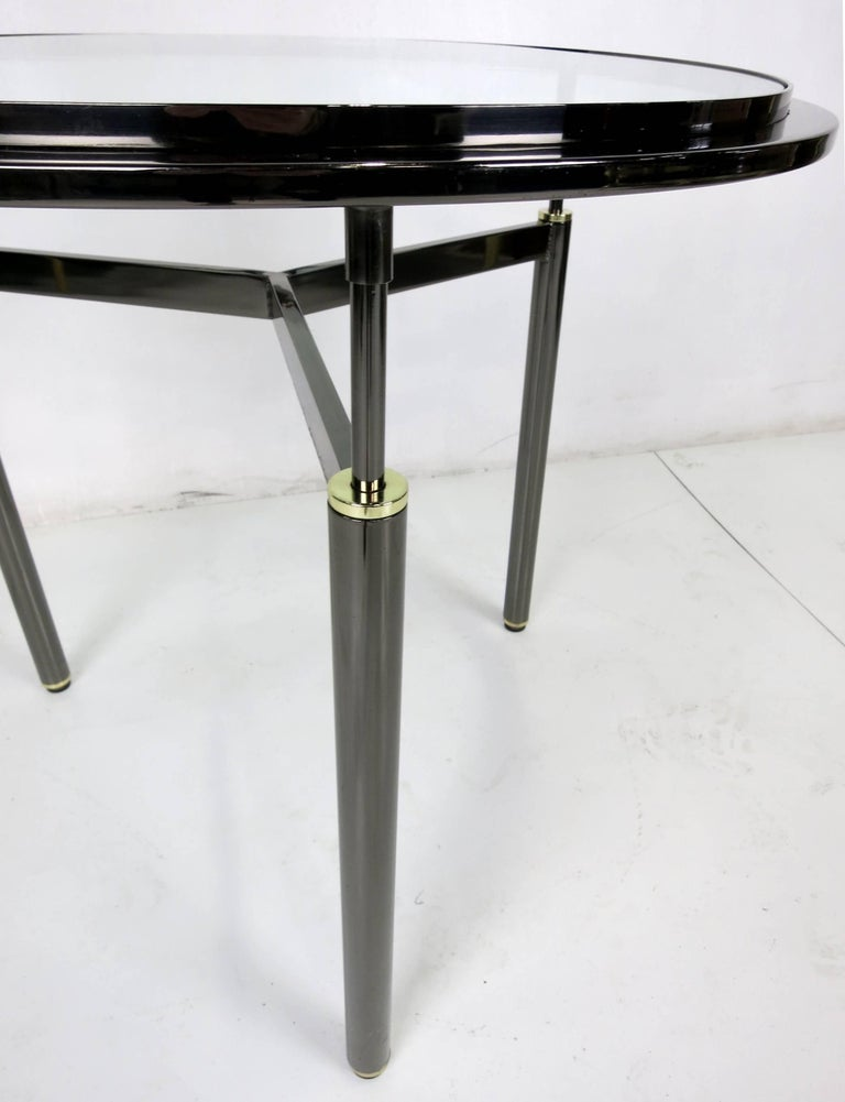American Pair of Gunmetal and Brass Tripod Gueridons in the Style of John Saladino For Sale