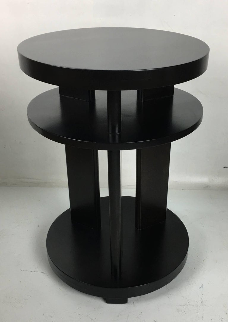 Pair of mahogany occasional tables by Paul Laszlo refinished in dark brown lacquer.  Top quality materials and workmanship.