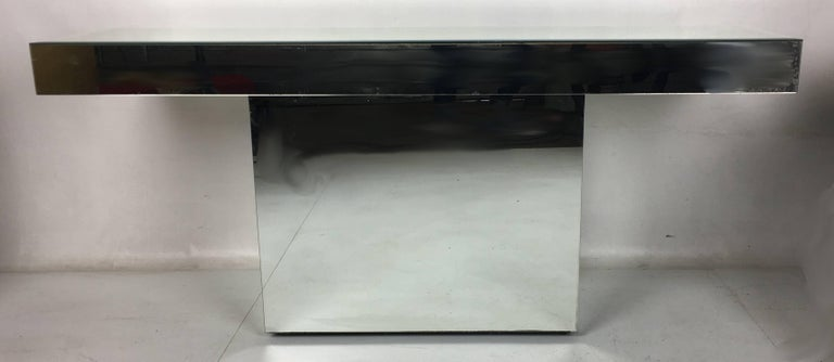 Mirror Clad Console Table with Pedestal base.  The top features a beveled edge.  The piece is in perfect vintage condition with no chips or damage.