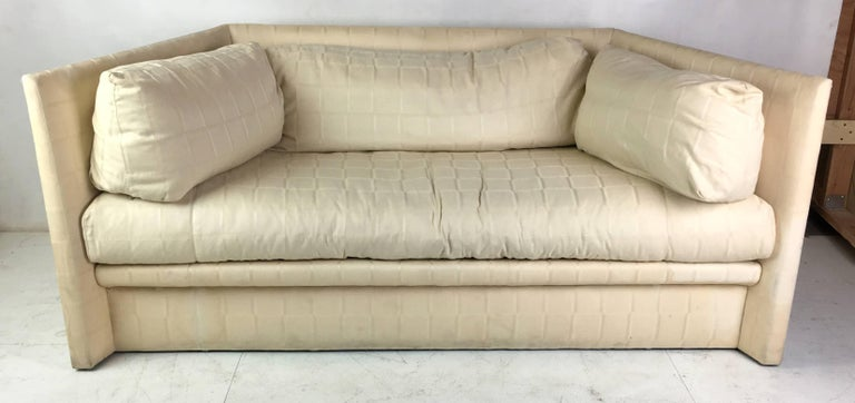 Fantastic shelter sofa with angled sides and down cushions by the Master, John Saladino, for Baker Furniture. This fantastic occasional piece is unbelievably lounge-y and comfortable while looking as stylish as it gets, as expected from Saladino.