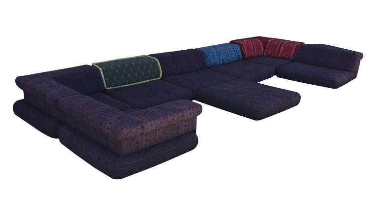 Huge first-edition version of Roche Bobois' Mah Jong sectional sofa. This chic piece consists of 15 pieces, three of which were reupholstered by the previous owner. Those three pieces appear taller in the photo because of the addition of the large