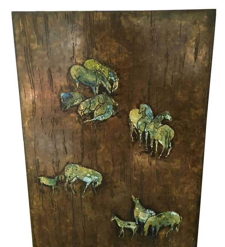 Exquisite large-scale etched bronze wall plaque depicting an ancient equine scene evocative of Lascaux. The panel features deep engraving along with dramatic polychrome figures. The plaque has a brazed-on-bronze frame and a patinated bronze back