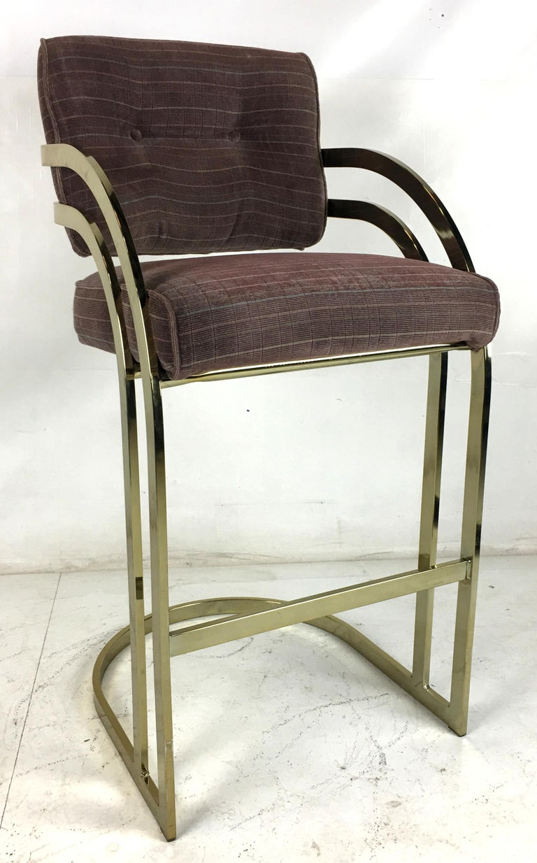 Beautiful set of four brass framed barstools. The set is in excellent original condition, including the upholstery.