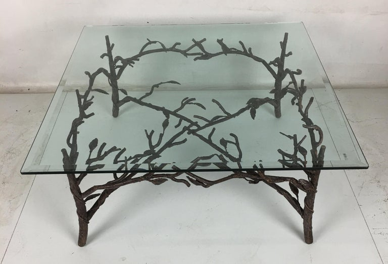 Chic faux bois coffee table in patinated metal with vined branches and leaves in the style of Diego Giacometti. The table is shown with a 36