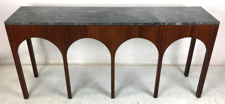 Rare and exquisite walnut console with deep green marble top by T.H. Robsjohn-Gibbings for Widdicomb. The table has been meticulously refinished in open grain Medium-dark Walnut lacquer. The top has been professionally polished and is in perfect