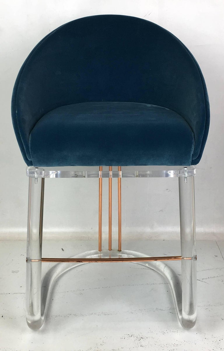 Beautiful pair of Lucite and brass barstools by Leon Frost. The barrel back seats swivel to a detente and return to center with a soft sprung mechanism.