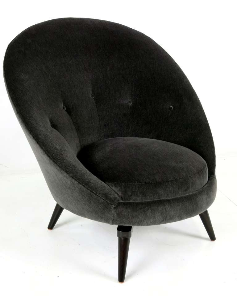 Pair of meticulously constructed egg chairs on spider leg swivel bases. The pair are freshly upholstered in luxurious heavy weight charcoal grey velvet.