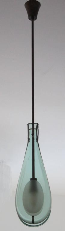 Italian modern  light green glass water drop pendant with patinated brass structure and fittings,  Max Ingrand design for Fontana Arte.