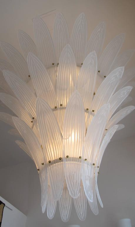 A monumental Hollywood regency style three-tier handblown textured Murano glass chandelier.