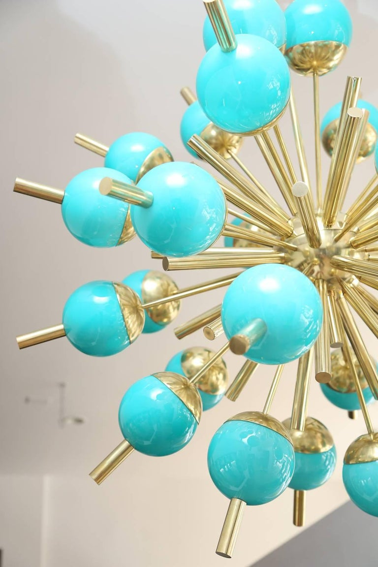 Modern Murano turquoise glass globes and brass Sputnik chandelier. 30 glass globes, all wired to the US standard and ready to install. Pair available.