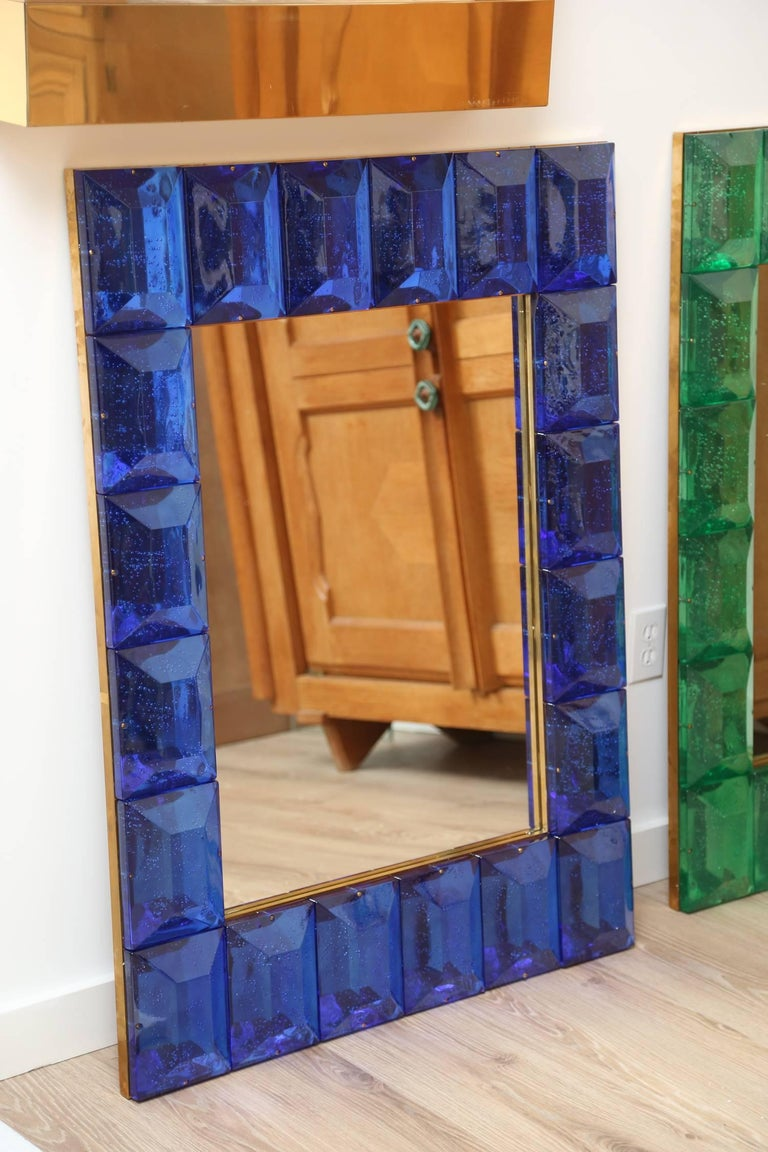 Customizable Faceted Murano Glass Mirror in Cobalt Blue   Contemporary and customizable mirror with a faceted Murano glass frame, edged in brass and handcrafted by a team of artisans in Venice, Italy. Each cobalt blue glass block has a highly