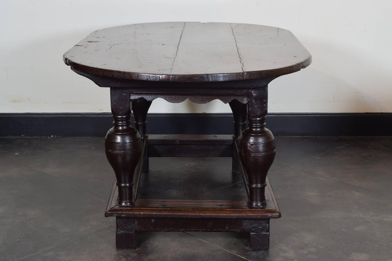 Flemish Carved Turned And Shaped Dark Oak Oval Table