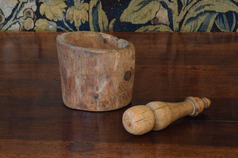 The hollowed branch carved to form the mortar, length of the turned pestle is 8 inches, both made of boxwood.