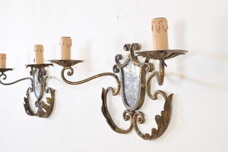 20th Century Pair of Italian Gilt Metal and Mirrored Two-Arm Sconces For Sale