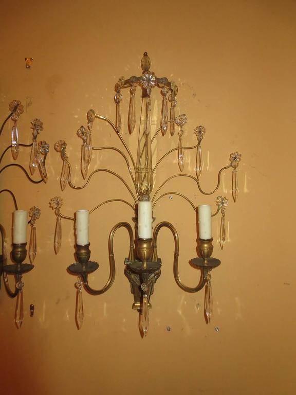Pair of early 20th century bronze and crystal sconces.
