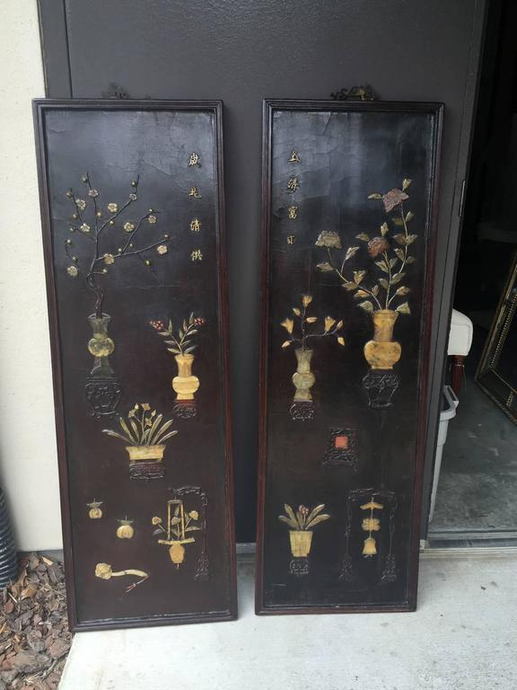 Pair of Chinese 19th century carved inlaid lacquered wooden panels.