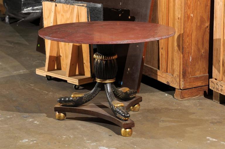 20th century Italian parcel-gilt center table.