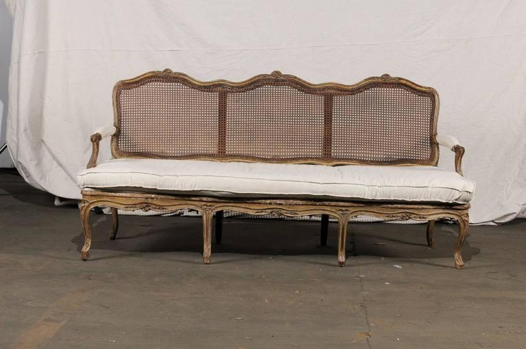 18th-19th century Regence settee with cane.
