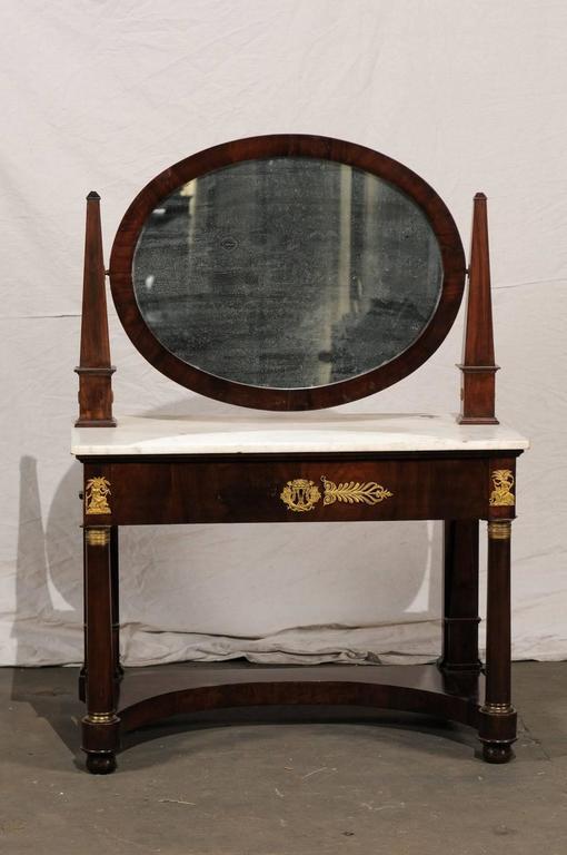 19th century Empire flame mahogany dressing table.