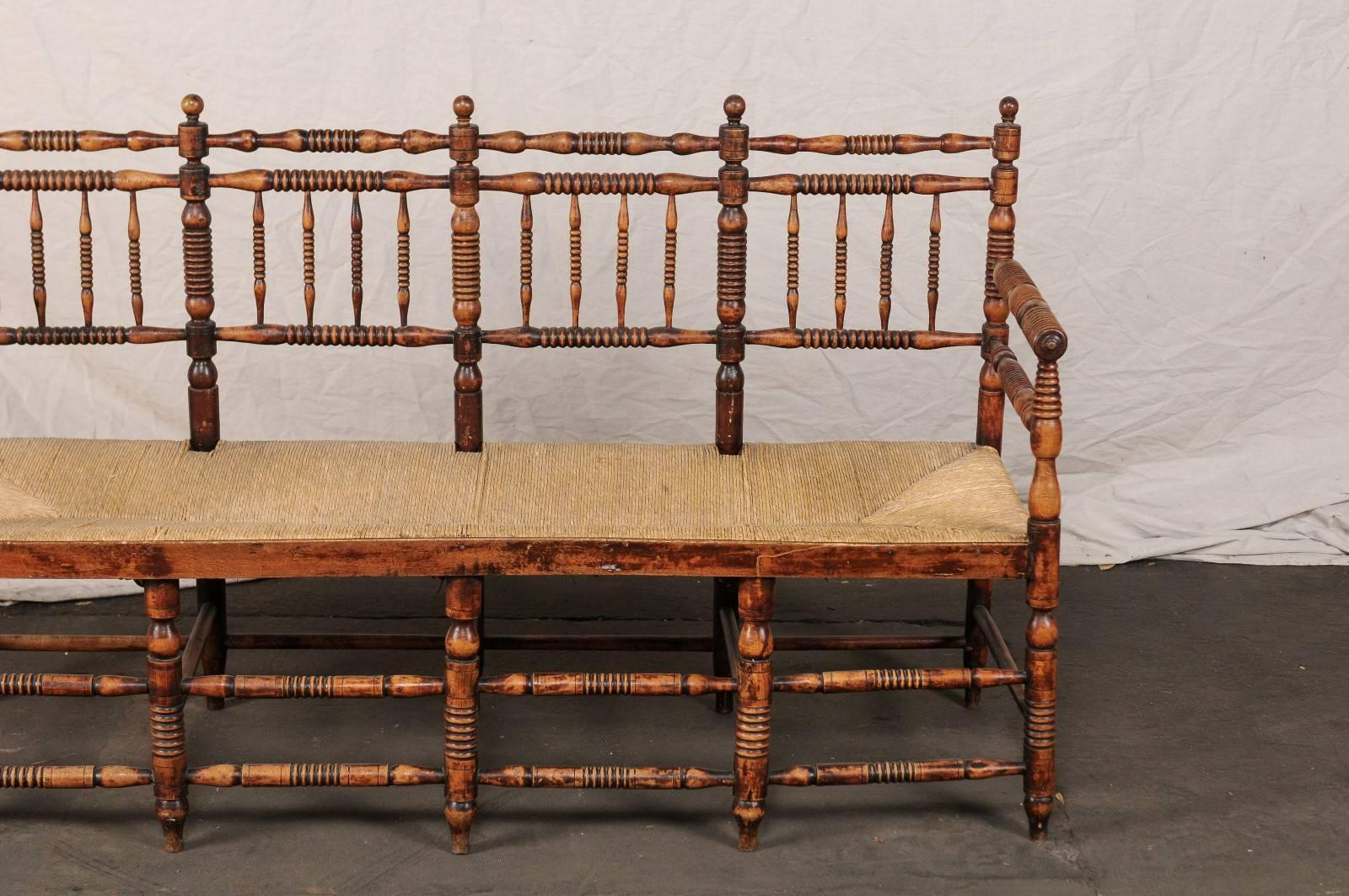 19th Century American Rustic Bench With Spindled Back And Woven Seat In  Good Condition For Sale