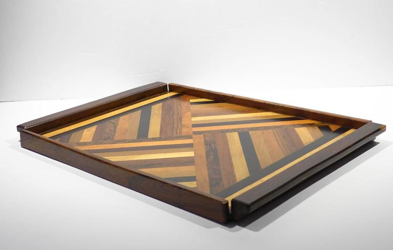 Large tray with cocobolo edges and a mix of exotic tropical woods in a marquetry pattern. By expat designer Don Shoemaker, produced at his Senal, S.A. studio, Morelia, Mexico, circa 1960s. Retains original label.