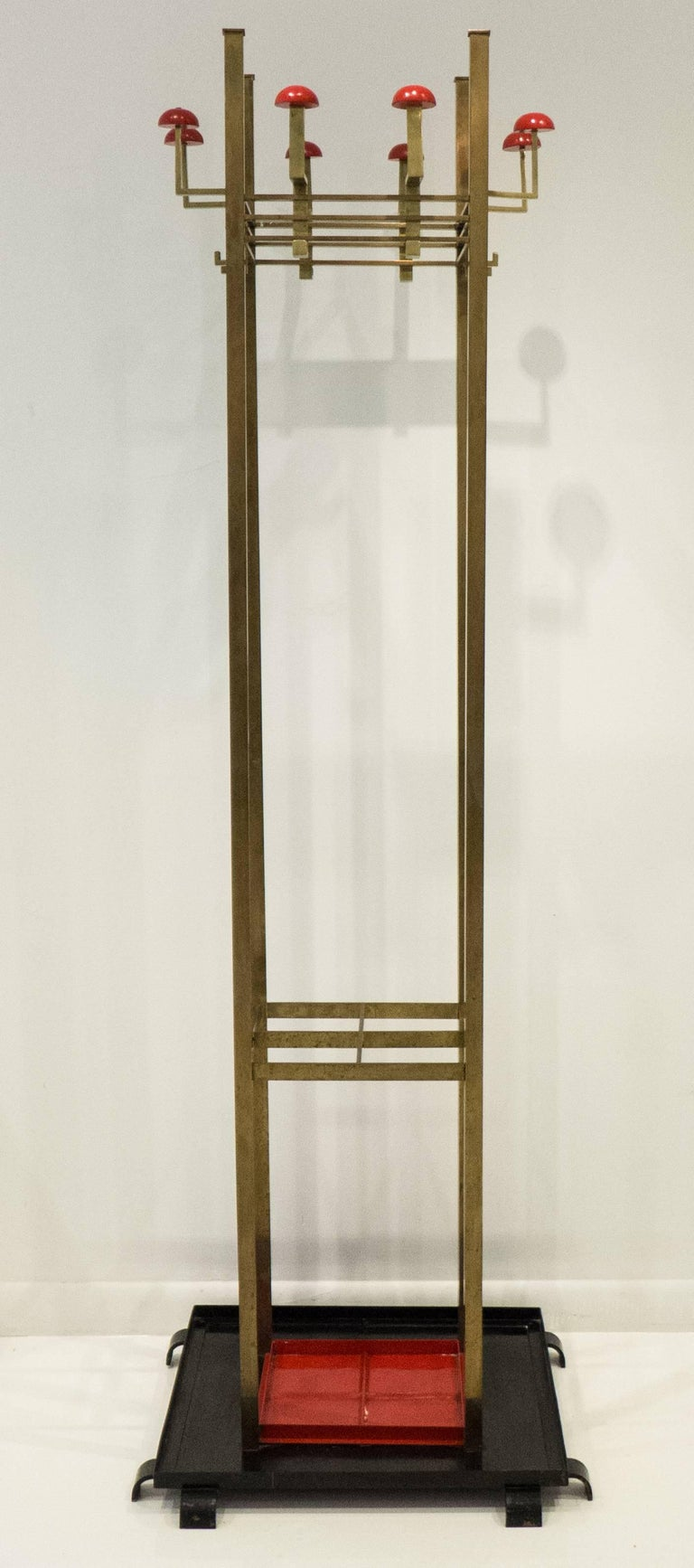 Tall Secessionist coat stand or hall organizer of brass, painted steel, and painted wood. Produced by S.A. Loevy in Berlin, circa 1915. S.A. Loevy was founded in 1885 as a bronze foundry specializing in art casting. The company evolved to produce a