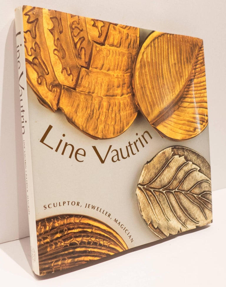 Lin Vautrin: Sculptor, Jeweller, Magician.  First American edition, hardcover in dustjacket, published by Thames and Hudson in 1992.  112 pages, featuring 76 pages of illustrations, 72 of them in color--over 200 objects plus commentaries.  A