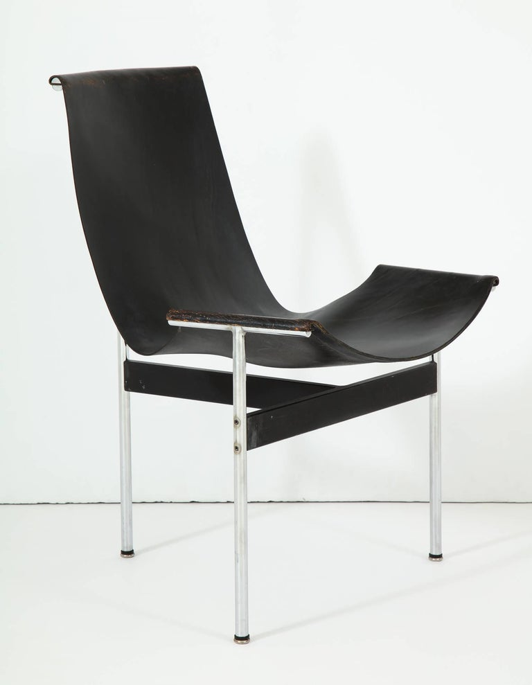Early production T-chair in chrome-plated and enameled steel with original black leather sling, designed by Pratt alums William Katavolos, Ross Littell, and Douglas Kelley. A cornerstone of the acclaimed Laverne International
