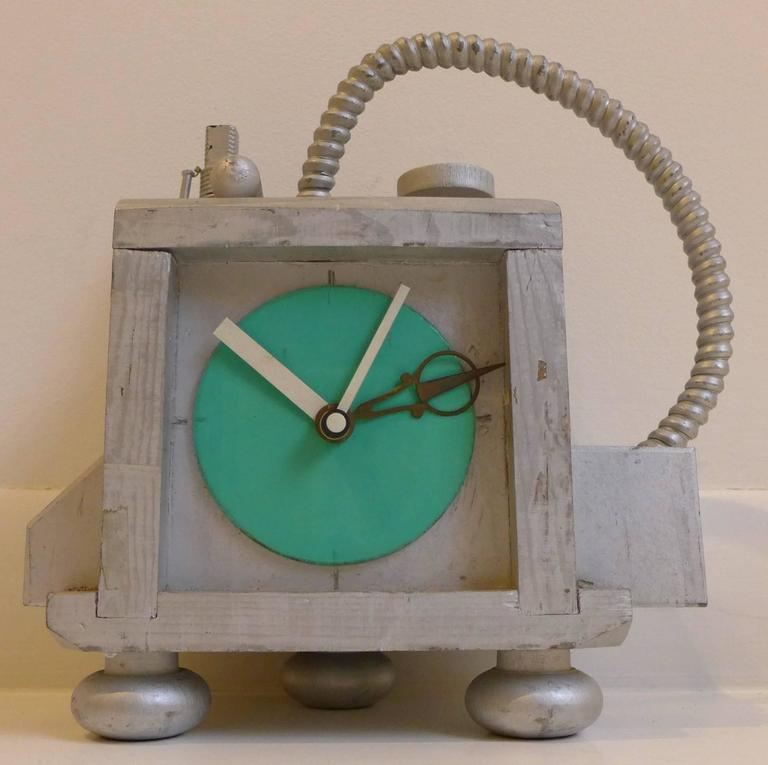 Relatively restrained fantasy clock by New York City artist Richard Birkett. An early example of Birkett's post-modernist, steampunk oeuvre, dated 1985 (he began making these clocks in 1984). Birkett recycled industrial debris such as machine parts,