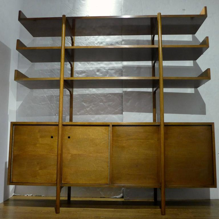 Divider or storage unit designed by Milo Baughman for Glenn of California, and produced, circa 1950. An early Baughman design suited to the purpose of dividing open-plan space. The case has doors that open on either side, with an adjustable shelf in