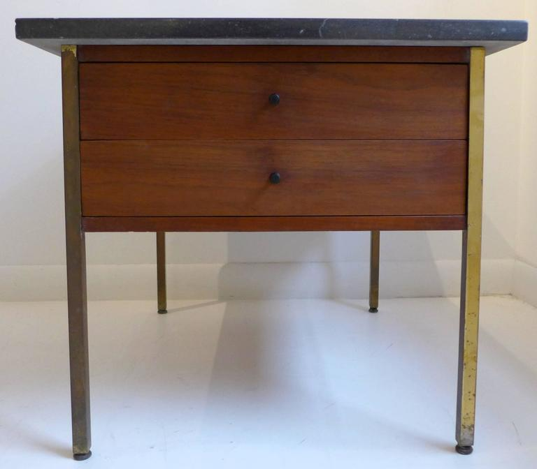 Side table or end table in walnut with brass legs, turned wooden pulls, and a travertine marble top. Designed by Milo Baughman for Arch Gordon, circa 1957. A nicely produced Baughman design, rarely seen compared to his work for Thayer-Coggin. Ref: