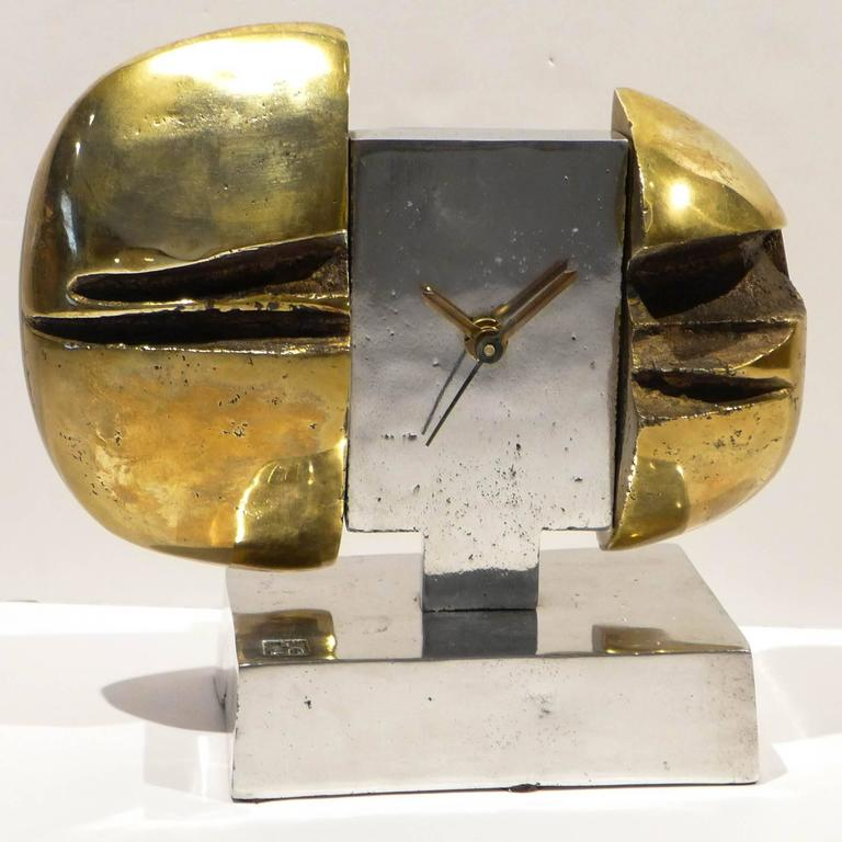 Brutalist clock of cast bronze and cast aluminum by Scottish/Spanish/American artist David Marshall (b. 1943), executed, circa 1970. Marshall settled in Spain in the mid-1960s, opening a workshop in Malaga in 1969 where he produced sculpture,