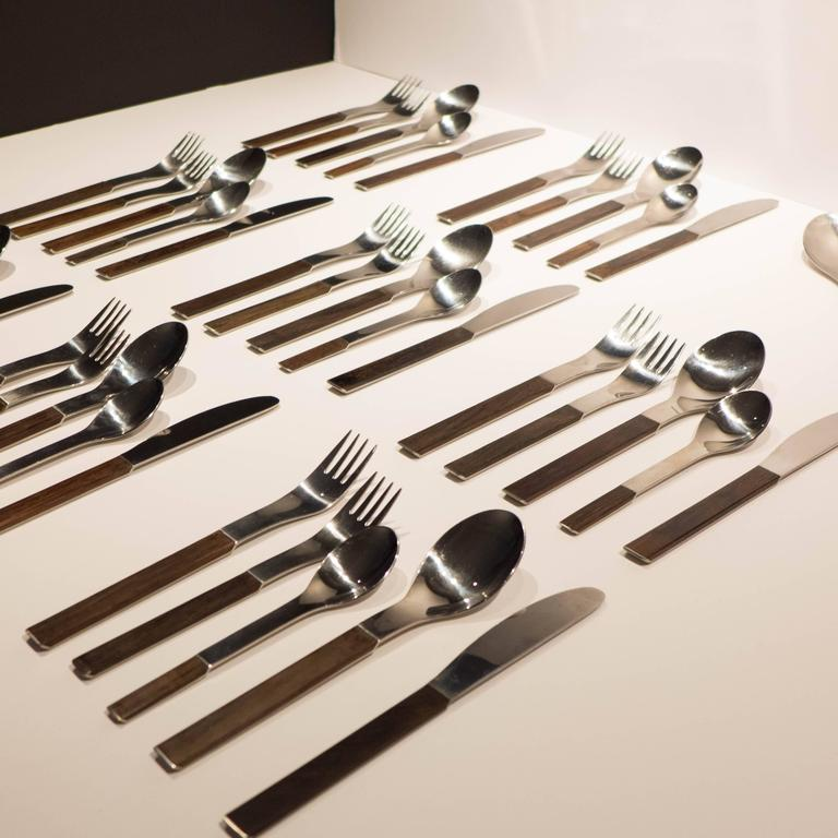 """Duo"" series flatware in stainless steel and rosewood by Carl Auböck III. A 1967 design produced by Neuzeughammer Ambosswerk for Rosenthal Studio Line, circa 1970. Five piece service for eight (dinner fork, spoon, knife, teaspoon,"