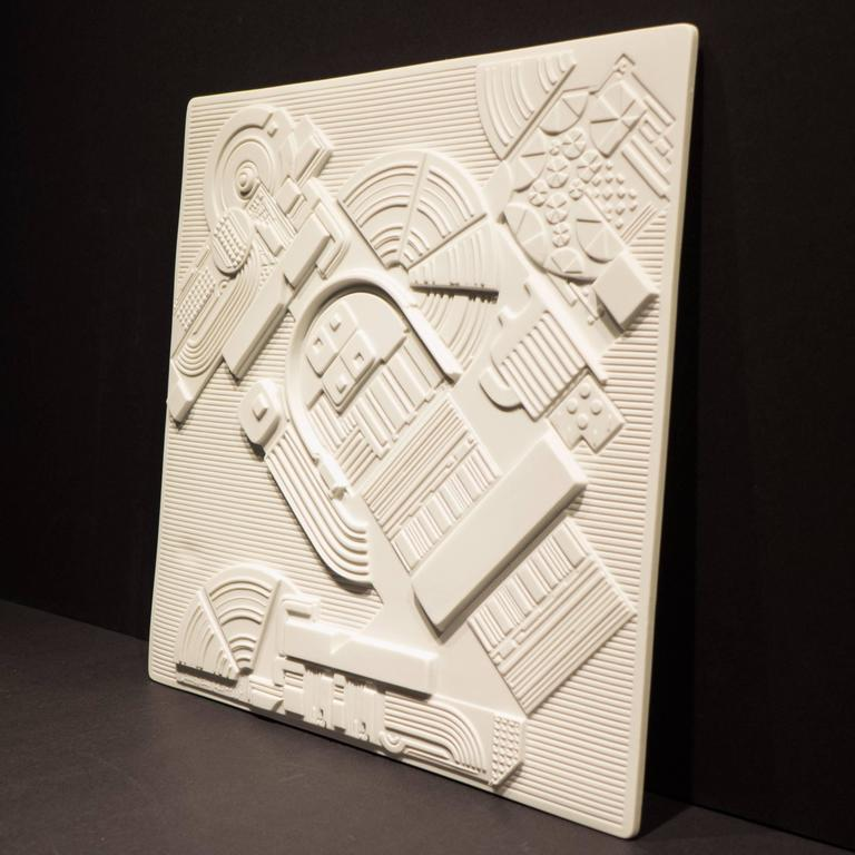 Porcelain wall sculpture or plaque in high relief by Pop Art Pioneer Eduardo Paolozzi. Produced by Rosenthal Studio Line in 1978 in a limited edition of 3,000 of which this is number 2852. The Jahresteller series consisted of an annual collaboration