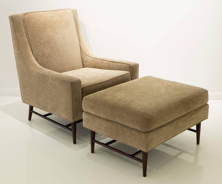 High-back lounge chair (model #468) with mahogany legs and cross-stretchers; along with the corresponding ottoman (model #468A). Designed and produced by Harvey Probber, c. 1950's. Reupholstered in the past eight years. A substantial and comfortable