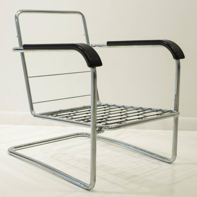 Cantilevered tubular chromed steel armchair with bakelite armrests, model WB 21, designed by Swiss architect Werner Max Moser in 1930 and produced by Embru Werke, circa 1935. A classic, elegant, and well-made Swiss Bauhaus design, this is the first