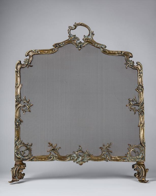 AFP0530 An antique bronze Louis XV fireplace screen with iron mesh.  Dimensions: Overall: 31-1/2