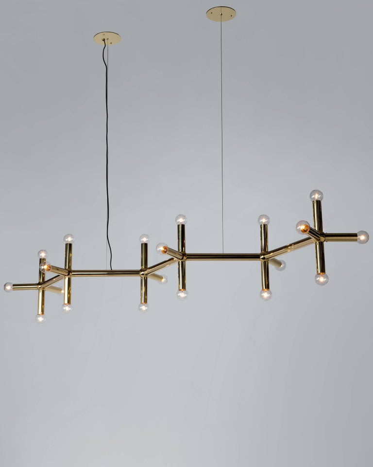 Inspired by the original midcentury Atomic Lichtstruktur designs of Swiss architect Robert Haussmann, built in 1965 for the Ingolstadt theater. Each fixture is individually crafted and hand finished to your specifications in Brooklyn of solid brass