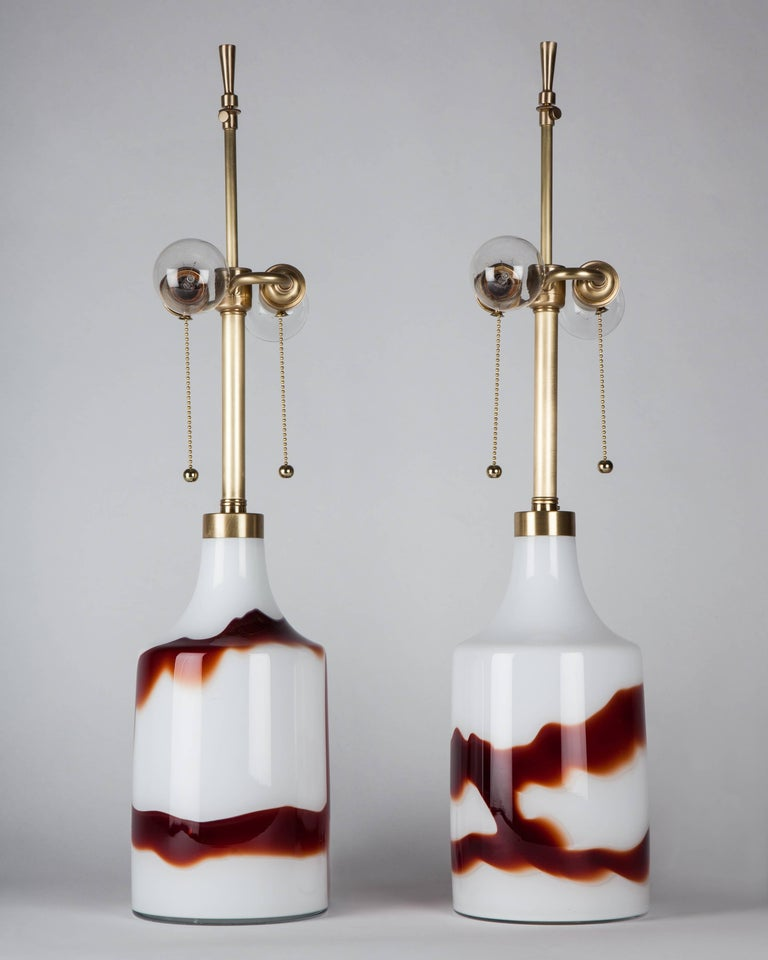 ATL1974 circa 1970 A pair of crimson and white cased glass