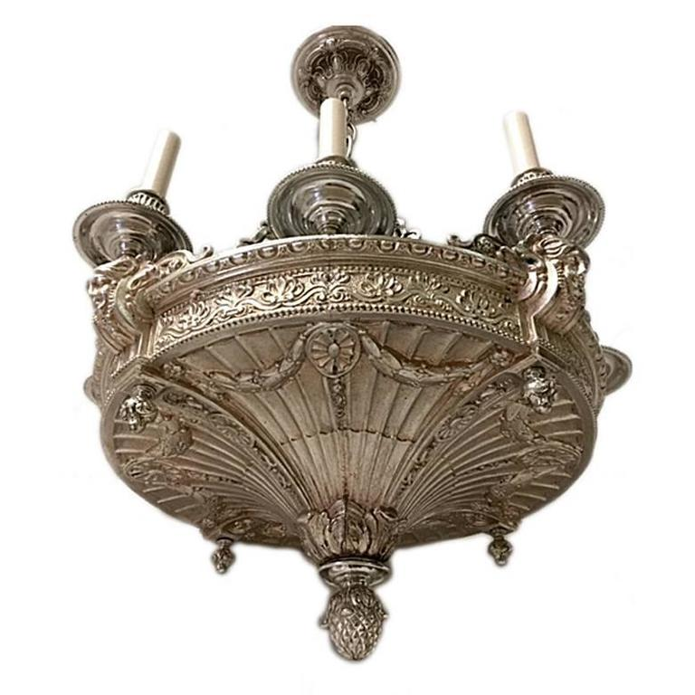 Turn of the century American silver plated chandelier with eight lights, with garlands and foliage motif. Measures: 32