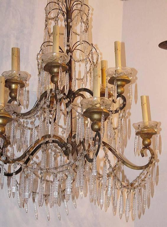 A late 19th century Italian gilt metal chandelier with crystal pendants, ten lights.   Measures: 43
