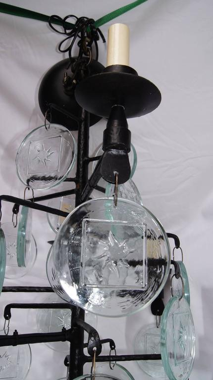 Swedish Pair of Wrought Iron and Molded Glass Chandeliers For Sale