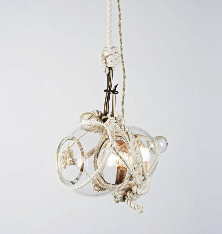 Heavily inspired by Japanese packaging and maritime culture, knotty bubbles is a sculptural light made of hand-blown glass globes tied together with knotted rope. The handmade nature of the knotty bubbles ensures that each is a unique piece.  Please