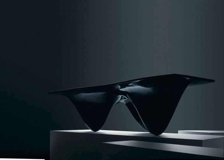Zaha Hadid design icon inspired by the movement and fluidity of water. Available in black or white, matte or glossy finish.  Limited edition of 39 available  Pricing is for polyurethane gloss finish in black. Please inquire for pricing for other