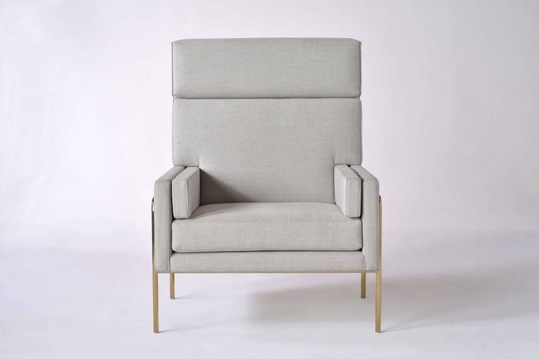 Akin to a tailored three-piece suit, the Trolley Lounge chair's upholstered pieces are nestled in a determined, yet elegant frame.  Pricing is for smoked brass or burnt copper frame. Please inquire for polished chrome or powder-coat frame