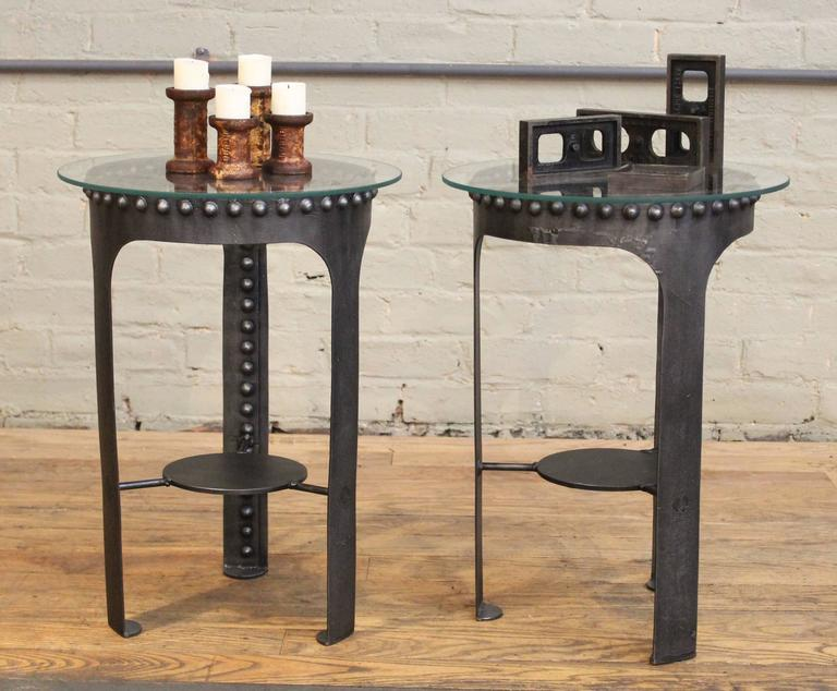 "Vintage Industrial Brutalist Riveted steel, metal and glass end, side tables. Pair two (four and five) in a set of five. 13"" in diameter, (15"" diameter glass) 20 1/4"" in height with glass. Vintage Industrial by Get Back, Inc."