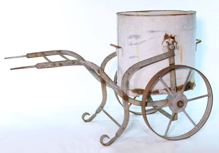 Antique French hand-carved wrought iron and zinc water barrow from the early 20th century would have been used to collect rainwater and then carted around to water the gardens. Measures 60
