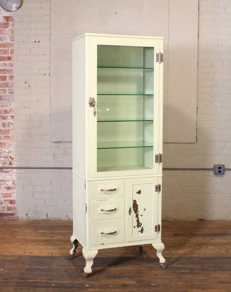 Vintage distressed Doctor's medical display storage cabinet made from steel, metal and glass. Measures 70 1/4